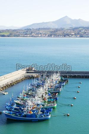 high angle view of trawlers docked