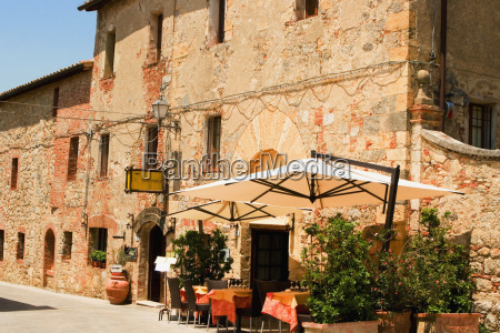 potted plants and patio umbrellas in