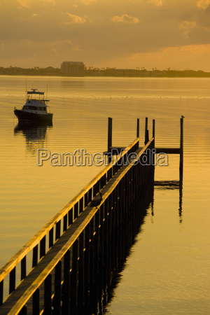 pier and a boat in the