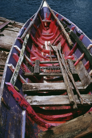 an old painted boat with an