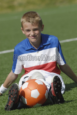 portrait of a soccer player sitting