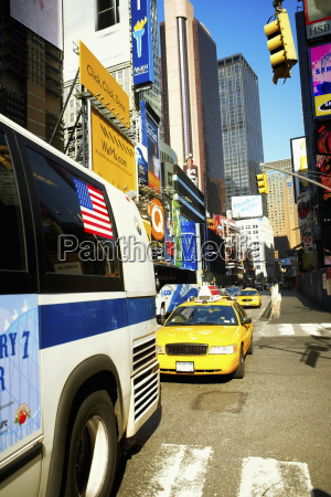 bus and yellow taxi moving on