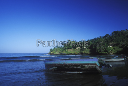 fishing boat on the beach caribbean