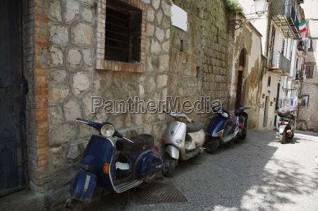 motor scooters parked in front of