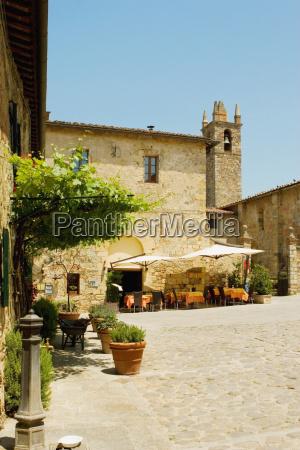 sidewalk cafe beside a church romanesque