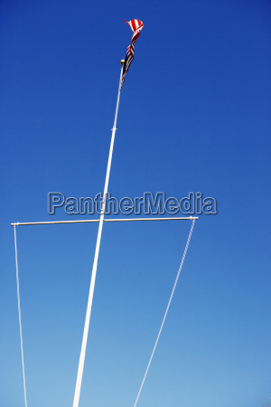 low angle view of boat mast