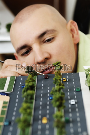 male architect making an architectural model