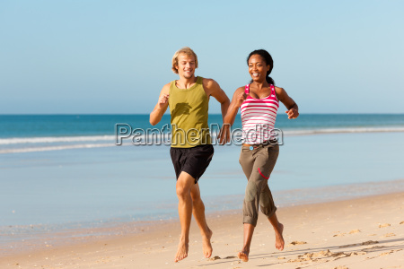 sport couple while jogging on the