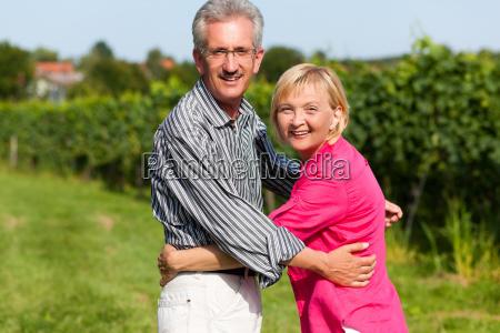 elderly couple walk