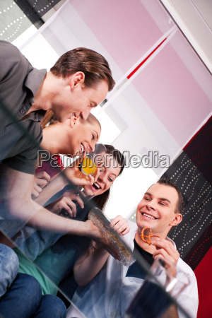 two couples have a leisurely time