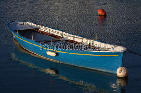 a blue boat moored in the