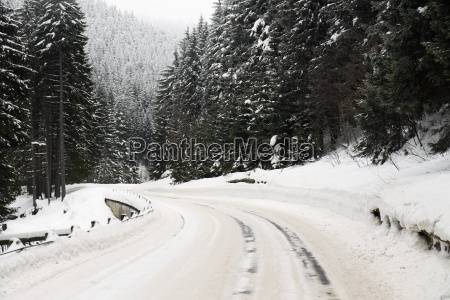 road curve in winter with lot