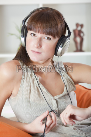 woman with earphones at home