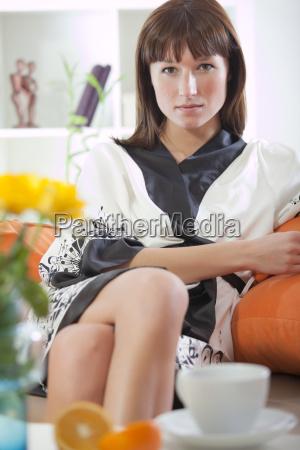 woman in bathrobe relaxing