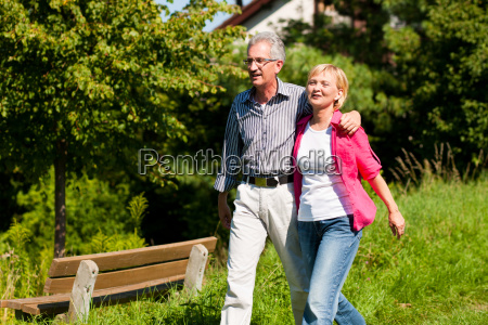 elderly couple walk