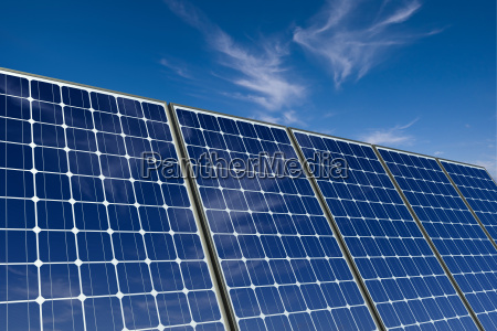 solar modules in front of blue