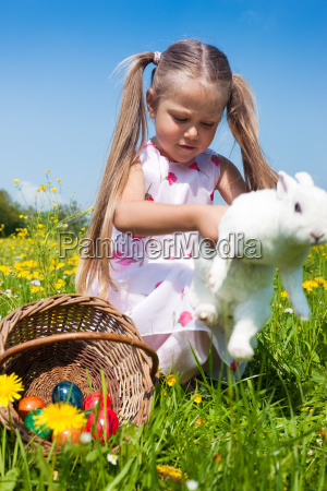 small child plays with the easter