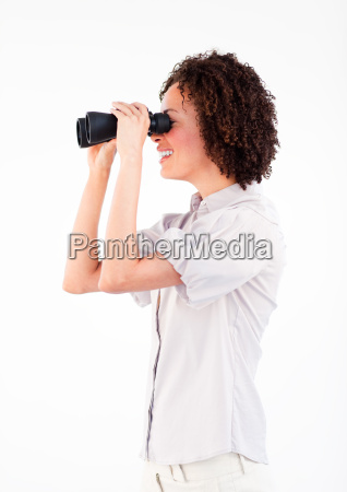young businesswoman looking through binoculars