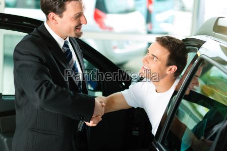 man buys car at the dealership