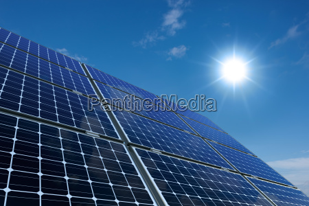 monocrystalline solar panels in front of