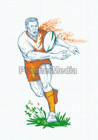 rugby spieler laeuft und der kugel