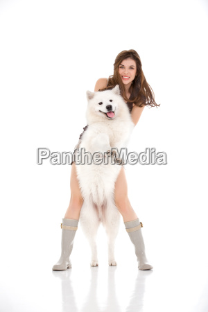 young woman and white dog standing