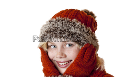 young blond girl with winter cap