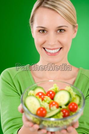 healthy lifestyle woman holding vegetable
