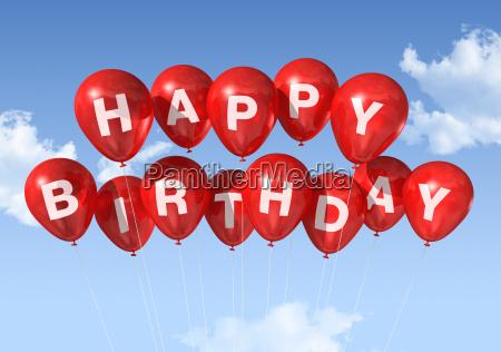 red happy birthday ballons in den