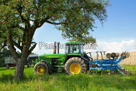 tractor blends in beautiful rural landscape