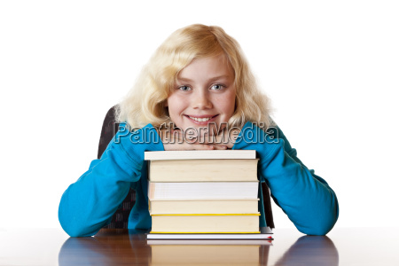 happy schoolgirl leaning on books