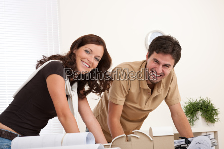 smiling man and woman working