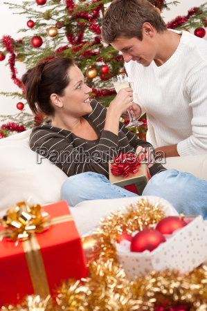 young couple with champagne in front