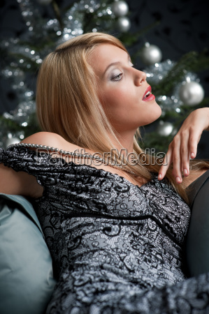 provocative woman posing in gray dress