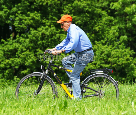 senior cyclist in nature