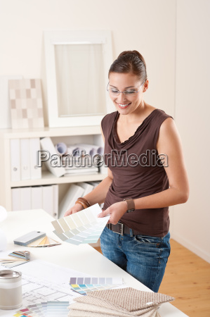 young female designer working at office