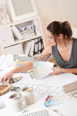 female interior designer working with color