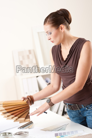 young female designer with wooden color