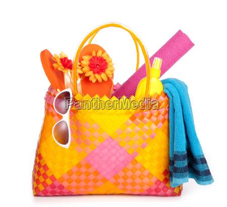 beach bag towel basket suntan sunglasses