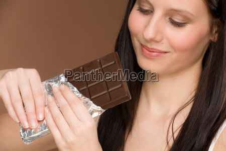 chocolate portrait young woman bite
