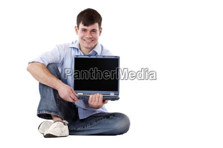 young man showing blank laptop screen