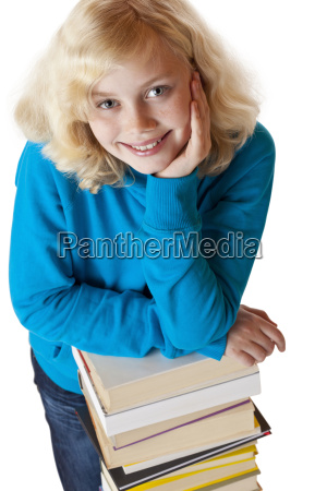 young girl supports books stack