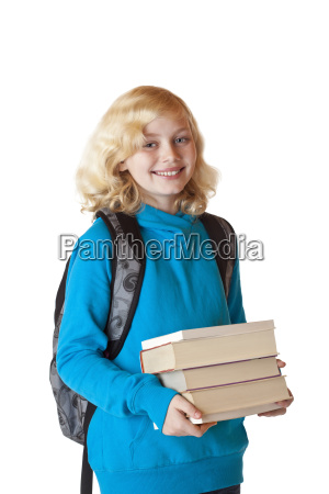 schoolgirl with backpack and books