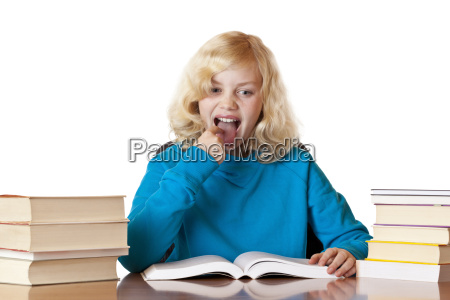 blonde pretty schoolgirl sitting at learning