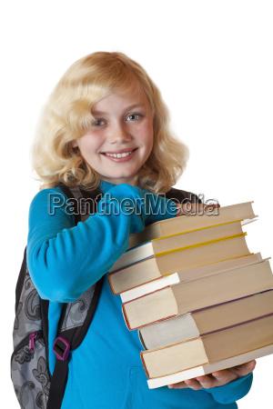 female student holding smiling school books