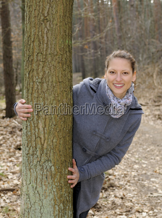 cheerful young woman in the forest
