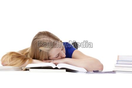 young attractive schoolgirl is sleeping on