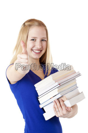 happy student with books showing thumbs