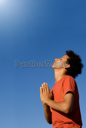 mixed race christian teen praying