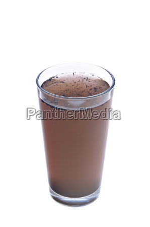 dirty water in glass isolated on